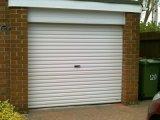 Porte sectionnelle en gros automatisée moderne de garage à vendre