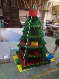 棚が付いているクリスマスツリーのCardbordの表示、ギフトのための屋外広告のフロア・ディスプレイの立場