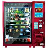 Distributore automatico rosso e del frutta della bevanda a base di latte nella vicinanza
