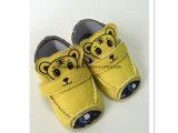 Chaussures de bébé blanches bleues de piste