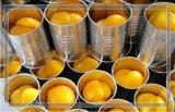 Pêche en boîte fraîche, pêche jaune en boîte, conserve de fruits