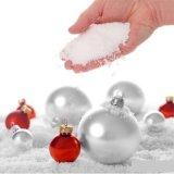 La polvere falsa artificiale istante della neve magica della decorazione di natale aggiunge appena l'acqua