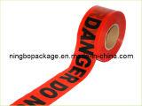 バリケードテープ赤くおよび白い注意テープ