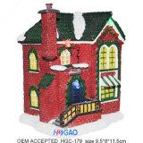 Casa de la galleta del navidad de la resina con la iluminación