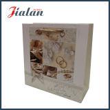 Самая новая конструкция продает мешок оптом подарка бумажного венчания лоснистого слоения изготовленный на заказ