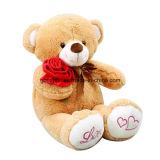 ローズが付いている美しいテディー・ベアのプラシ天のおもちゃ