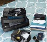 Вкладчик космоса перемещения кладет устроителей в мешки костюма упаковки хранения совершенных для магазина дома перемещения