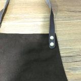 O avental resistente feito sob encomenda da lona com as cintas de couro de Genine vende por atacado