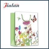 Flores con la bolsa de papel del regalo de las compras del papel de arte de recuerdos