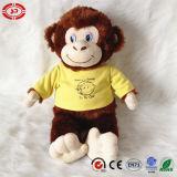 Scimmia di seduta con il giocattolo della scimmia della peluche del CE reso personale maglietta gialla