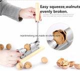機械殻をむく人のクルミのくるみ割りのナットのクラッカーはオープナ絶食する