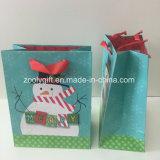 Noël personnalisé par bonhomme de neige éclatant vend les sacs de papier de cadeau