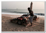 O lixo da praia coleta a máquina