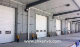 自動PUサンドイッチパネルのモーターを備えられた産業オーバーヘッド部門別のガレージのドア