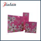 Il colore di colore rosa caldo personalizza i sacchi di carta resi personali stampati per gli indumenti