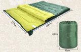 Das im Freienkampieren kann aufgespalteter einzelner Umschlag-Schlafsack sein