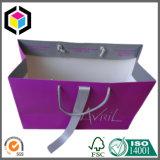 リボンが付いている贅沢な紫色の色刷のペーパーショッピング衣装袋