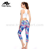 L'yoga ansima i pantaloni variopinti di yoga delle ghette delle donne