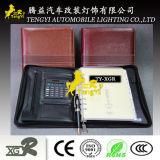 Cuaderno con la calculadora simple escuela de la oficina de la cartera