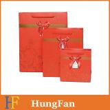 Color rojo y bolso de papel de sellado de oro del regalo de la boda
