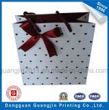 Papel de color rosa Impreso en color bolsa de regalo con la decoración de la cinta