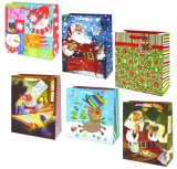 Подарок рождества кладет в мешки с штемпелями яркия блеска и фольги, бумажным мешком подарка, мешком подарка, мешком подарка бумаги Kraft