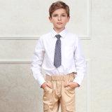 Chemises et pantalon bon marché de l'école du garçon et de la fille