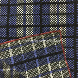 Немногая проверяет ткань шерстей для шинели