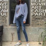 Nuovi jeans strappati del denim delle donne dei fori della molla