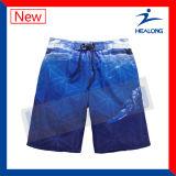 Projeto curto barato feito sob encomenda dos Shorts da praia dos esportes da nadada de Sublimatiob