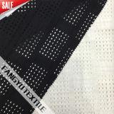 黒くか白い格子図形の綿のナイロンレースファブリック