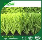 Hierba artificial verde para la dimensión de una variable del deporte U con la espina dorsal