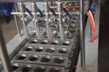Relleno de la taza del yogur y máquina automáticos llenos del lacre