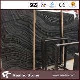 磨かれたブラックフォレストまたは美しい波の静脈が付いているケニヤの黒または銀の波か旧式な木の大理石の平板