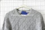 Suéter hecho punto cuello redondo para las mujeres