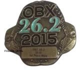 L'insigne d'Obx avec le bronze antique a plaqué 3