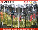 Máquina de embotellado del aceite de mesa con las botellas de cristal