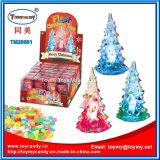 Светлая игрушка рождественской елки с конфетой