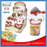 Bottiglia della caramella del contenitore di natale con la caramella della frutta