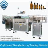 Etiqueta giratória que anexa a máquina para frascos do animal de estimação da bebida