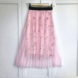 格子縞花の前部ボタンの無地の伸縮性があるウエストによってプリーツをつけられる小型スカート