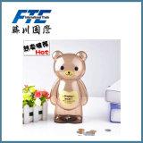 La Banca di moneta felice della Banca Piggy dell'orso del fumetto di plastica per raccogliersi