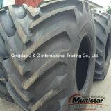El alimentador de granja alza y afronta los neumáticos en 405/70-24