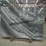 Отрезанный таможней сляб белых мраморный плиток пасмурный серый мраморный
