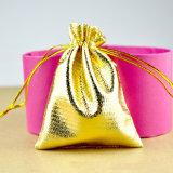 Saco de Drawstring pequeno do presente da cor do ouro do Natal