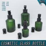 Botella de cristal cosmética helada del aerosol del hombro de la inclinación del verde y tarro poner crema del vidrio