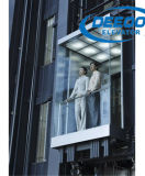 Elevatore facente un giro turistico della baracca di vetro di paesaggio