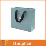 Bolsos de papel impreso de un color con manija de cinta