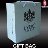 Bolso de papel de lujo del regalo de las compras con la impresión de la insignia para la ropa