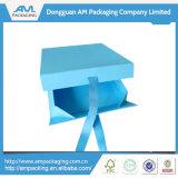 Rectángulo de regalo plegable de encargo del papel azul con la venta al por mayor del encierro de la cinta